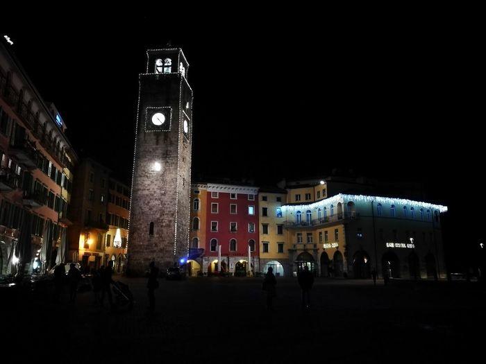 Illuminated clock tower at night