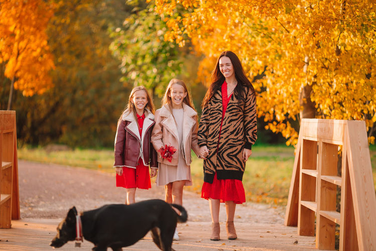 Group of people with dog during autumn