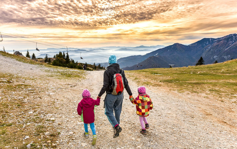 Active Active Family Active Lifestyle  Beauty In Nature Bonding Childhood Daughter Elementary Age Family Father Girls Healthy Lifestyle Hike Hiking Leisure Activity Lifestyles Mountain Mountains Mountaneering Trekking Rear View Sunset Togetherness Trekking Trekking Nature Love Warm Clothing