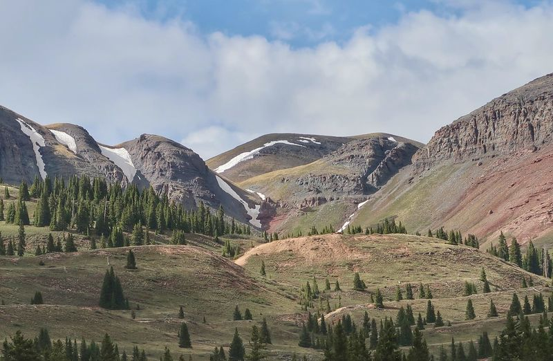Landscape of trees colorful hills and mountains in Colorado Snow San Juan Mountains Little Molas Lake Colorado Sky Cloud - Sky Mountain Scenics - Nature Plant Landscape Beauty In Nature Nature No People Growth Rural Scene Land Agriculture Tranquility Tranquil Scene Environment Day Tree Field Mountain Range The Great Outdoors - 2018 EyeEm Awards