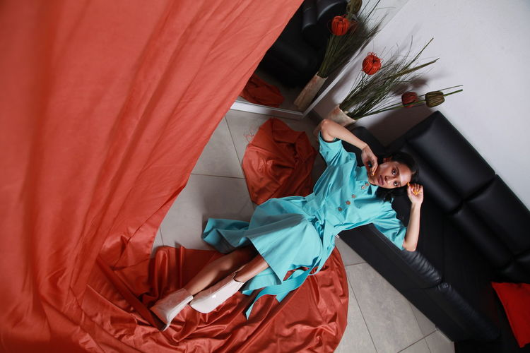 High angle view of woman with red umbrella