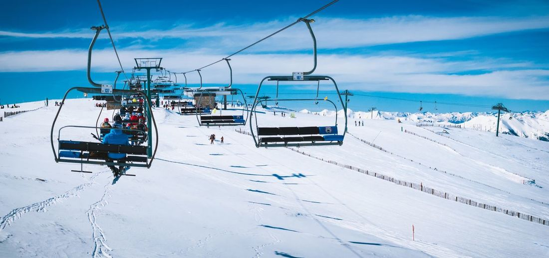 EyeEm Selects Cloud - Sky Sky Snow Ski Lift Transportation Go Higher Overhead Cable Car Day Outdoors Nature Mode Of Transport Winter Beauty In Nature Mountain Cold Temperature