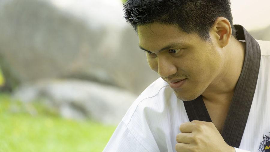 Close-up of man practicing karate outdoors