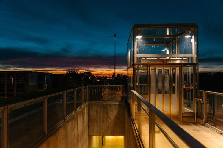 Illuminated building against sky at dusk