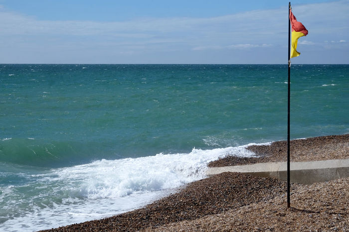Beach Beauty In Nature Day Flag Horizon Horizon Over Water Hove Hove Beach Land Motion Nature No People Outdoors Patriotism Scenics - Nature Sea Sky Tranquil Scene Tranquility Water Wave Wind