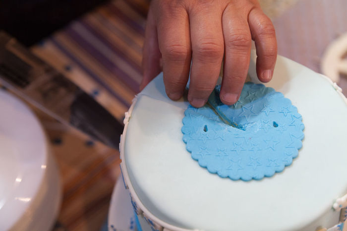 EyeEm Selects Human Hand One Person Adults Only Indoors  Sugar Sweet Biscuit Dessert Celebration Cut Knife Colorful Blue Cake Close-up Break The Mold Human Body Part Food One Man Only Adult Adults Only Working Day People