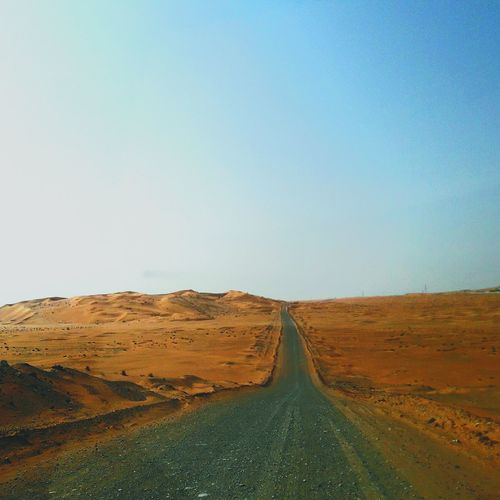 Paving Modernity Desert Road Unpaved Ungraded Metal Road Road In The Deser Road In Desert Long Way Ahead Rural Scene Clear Sky Agriculture Road Blue Sky Landscape