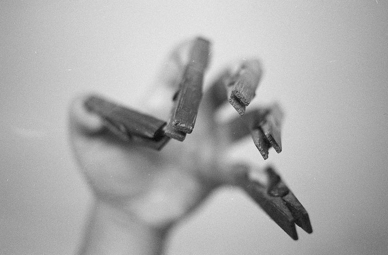 High angle view of human hand with clothespin