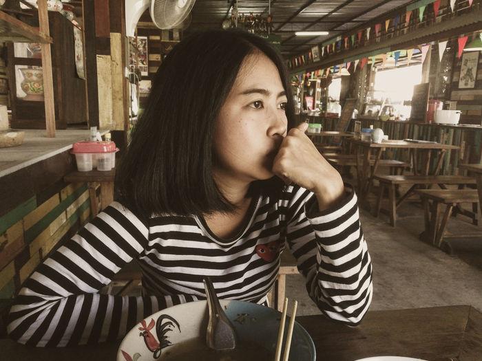 Asian girl waiting food in thai restuarant., with serious moment. Girl Asian Girl Serious Food Thai Restuarant Instapic Vintage Waiting Wait