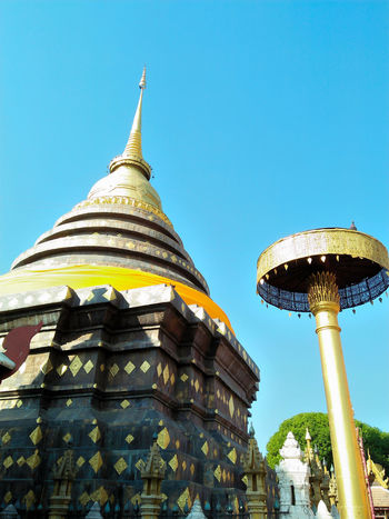 Architecture Blue Building Exterior Built Structure Clear Sky Day Gold Colored Lampang | Thailand Low Angle View No People Outdoors Place Of Worship Religion Sky Spirituality Travel Destinations