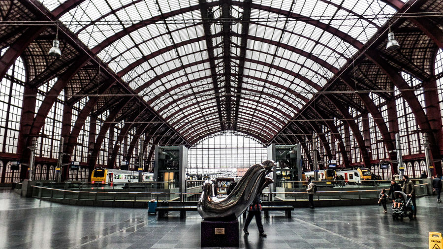 Indoors  Transportation Architecture Ceiling Travel Public Transportation Railroad Station Arch Mode Of Transportation Rail Transportation Group Of People Built Structure Men Real People Journey Passenger Train - Vehicle Railroad Station Platform Train Day Waiting