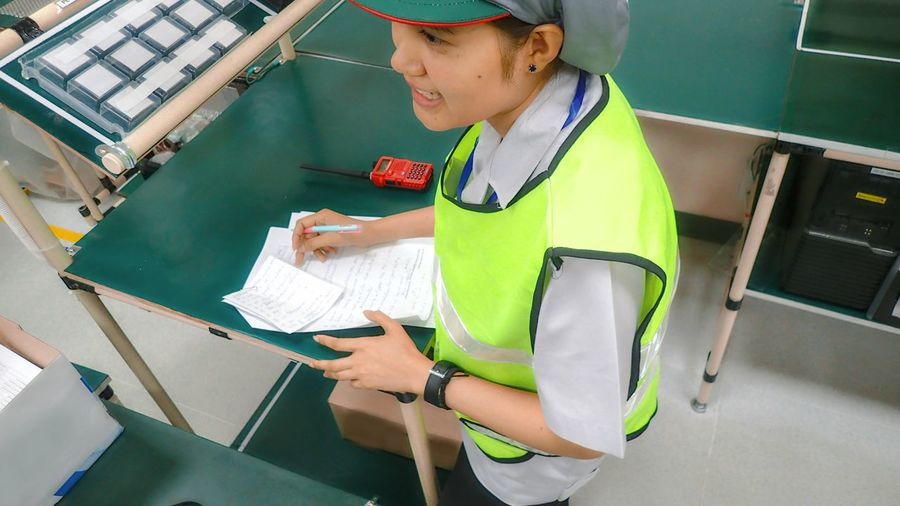 Side View Of Woman In Uniform Working