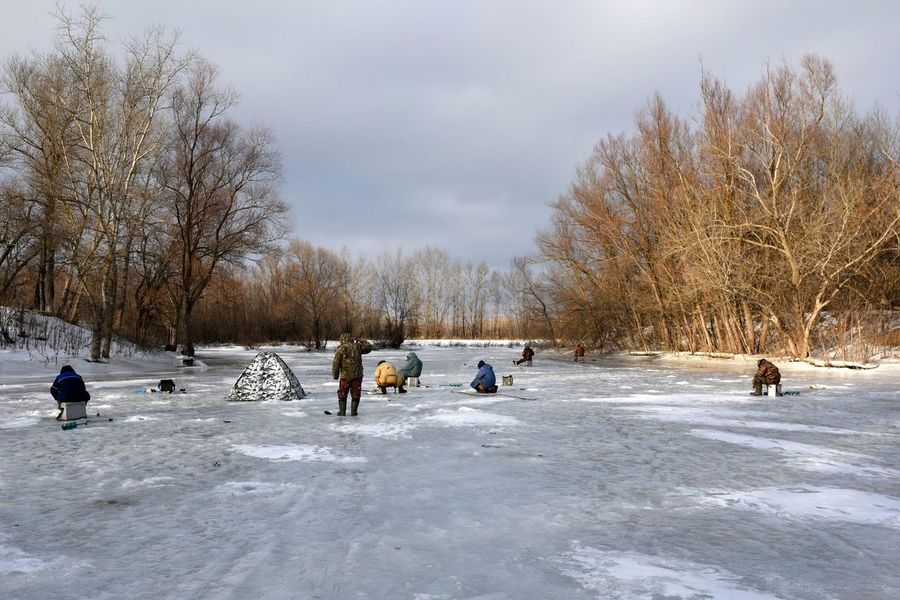 Back to the wind Cold Temperature Cold Wind Fisherman Ice Nature Outdoors People Under-ice Fishing Winter