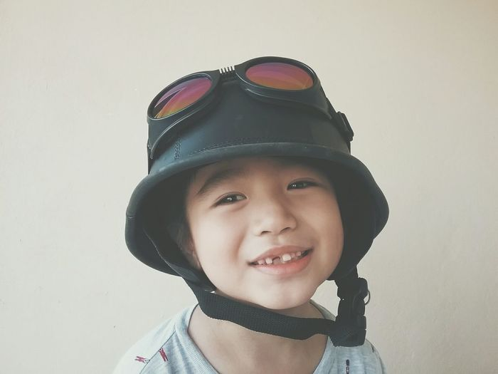 Portrait of a happy kid wearing motorcycle helmet Kid Motorcycle Helmet Portrait Happy Smile People Asian  6 Years Old Boy Smiling Child Close-up Day Natural Light Horizontal Toothless Childhood Headshot Innocence Happiness Front View The Portraitist - 2017 EyeEm Awards