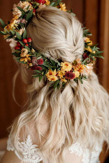 Rear view of bride wearing wreath standing indoors