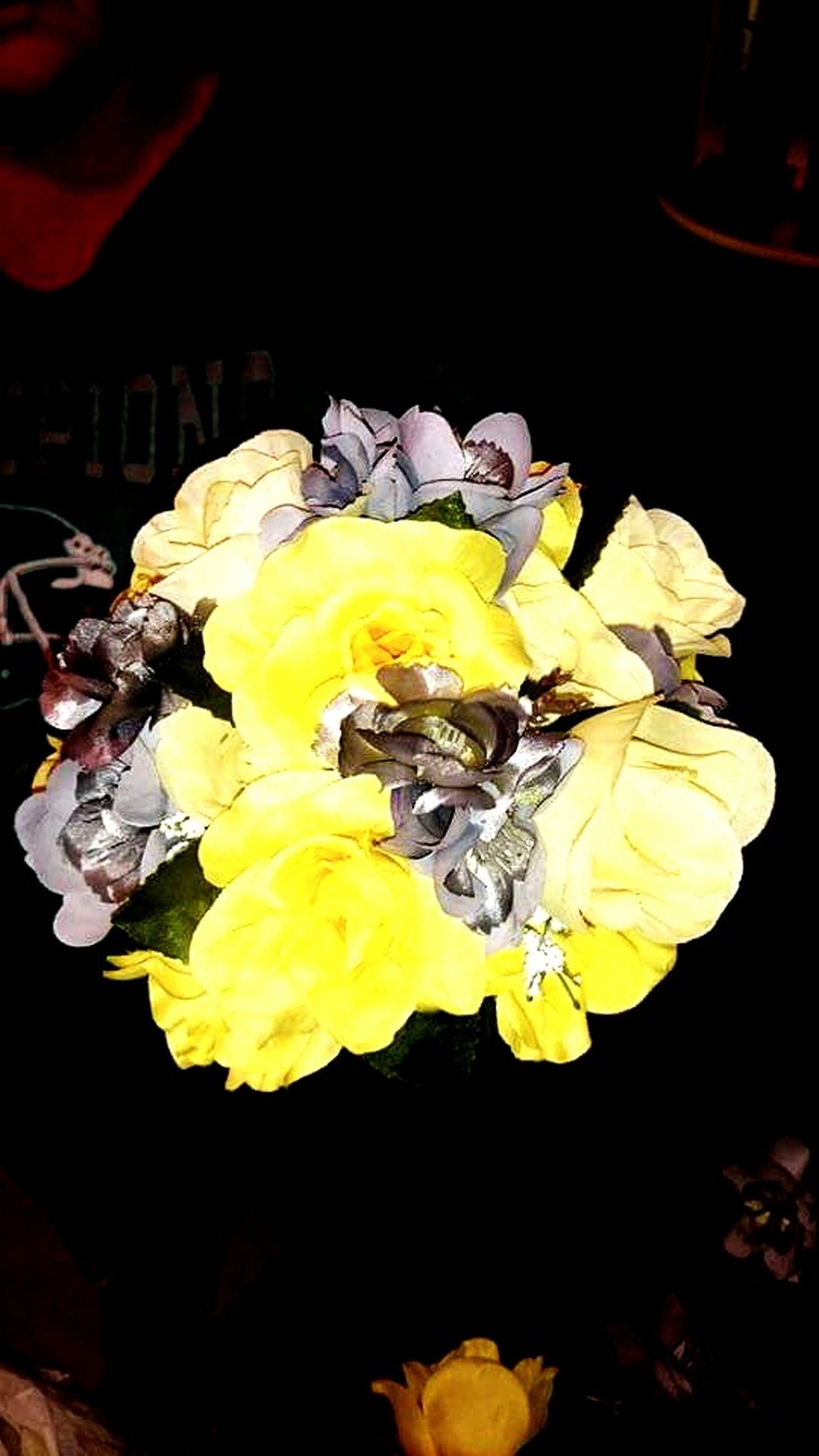 flower, yellow, petal, indoors, freshness, black background, close-up, fragility, studio shot, flower head, high angle view, still life, no people, nature, table, focus on foreground, beauty in nature, vase, rose - flower, bunch of flowers