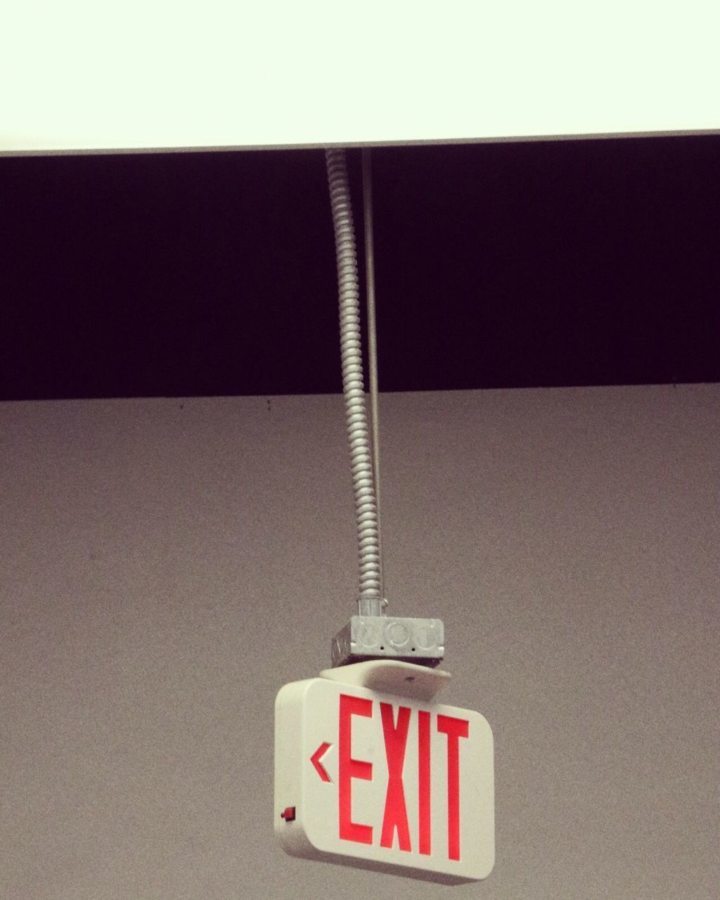 communication, indoors, no people, text, sign, close-up, hanging, wall - building feature, western script, cable, still life, technology, copy space, warning sign, information, plastic, number, safety, studio shot, connection