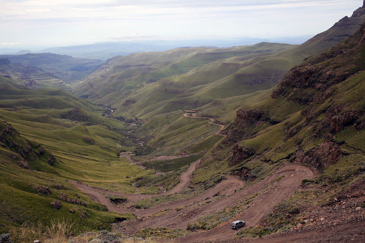 """""""Sani Pass iv"""" Scenics - Nature Landscape Tranquil Scene Beauty In Nature Environment Tranquility Mountain Non-urban Scene Sky Mountain Range Idyllic Day Nature Plant Land Cloud - Sky No People High Angle View Remote Green Color Outdoors Rolling Landscape Sani Pass South Africa Lesotho"""