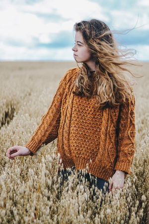Fields of Gold Wheat Wheat Field Adult Beach Beautiful Woman Beauty In Nature Close-up Day Leisure Activity Lifestyles Long Hair Nature One Person Outdoors People Real People Sand Sea Sky Standing Sweater Warm Clothing Women Young Adult Young Women