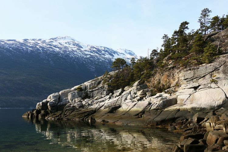 Smuggler's Cove in Skagway, Alaska April 2019 Mountain Water Rock Sky Nature Environment Scenery Landscape Beauty In Nature Reflection Rock - Object No People Scenics - Nature Cold Temperature Wilderness Outdoors Urban Skyline Tranquility Snow High Mountain Peak Mountain Range Height Smuggler's Cove Skagway Alaska Sea