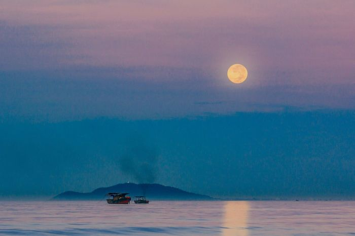 Full moon raising from sea My Traveling Photography From My Point Of View Sea Moon Scenics Waterfront Transportation Ship Boat Beauty In Nature Taking Photos Dawn No People Landscape Exceptional Photographs Composition