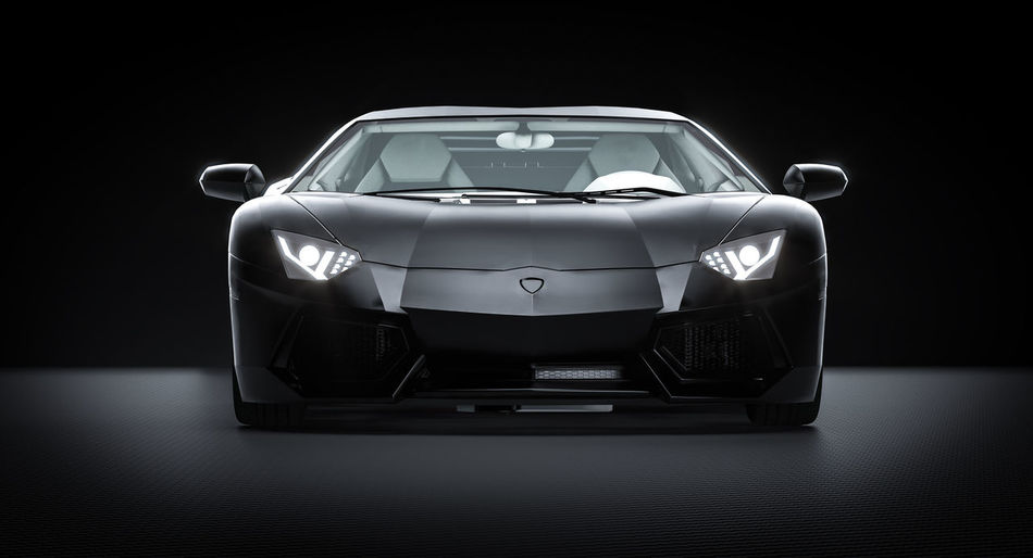 Close-up of car against black background