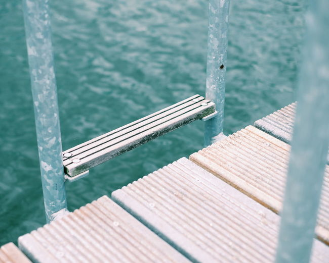 High angle view of ladder on pier over lake