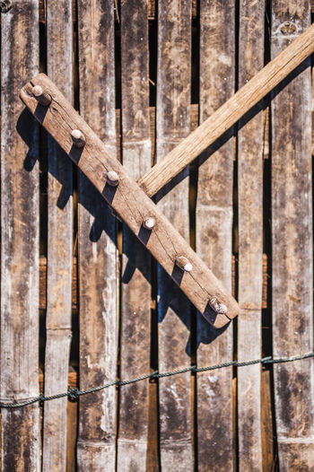 High angle view of wooden rake on planks