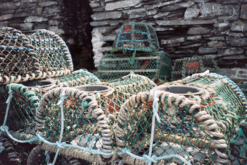 Lobster traps against stone wall