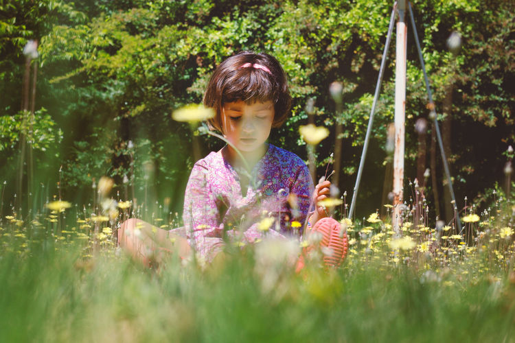 Candid Cheerful Child Childhood Day Flower Flowers Fun Grass Green Color Happiness Innocence Little Girl Nature One Girl Only One Person Outdoors Outdoors Photograpghy  Springtime Summer