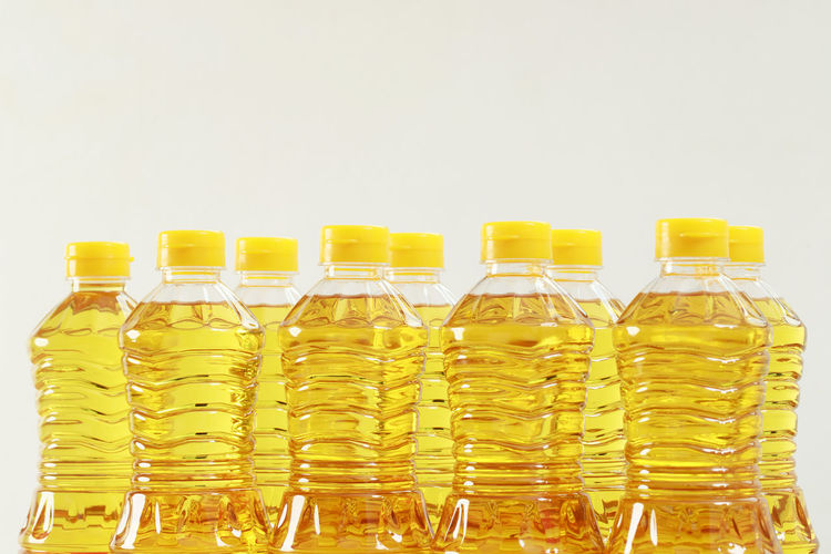 Close-up of glass bottles against white background