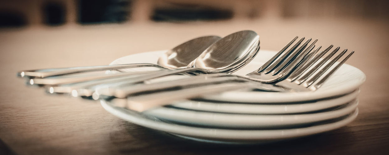 Close-up of eating utensils on table