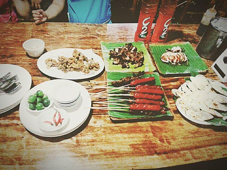 Filipinofood Chicharonbulaklak HotDog Inihaw Na Liempo Bakedtahong Grilledsalmonbelly Stuffedsquid Dinner