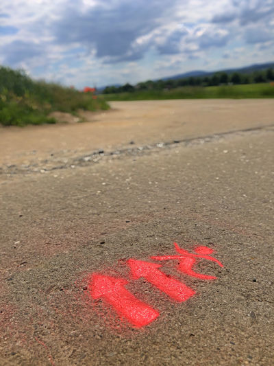 High angle view of text written on road