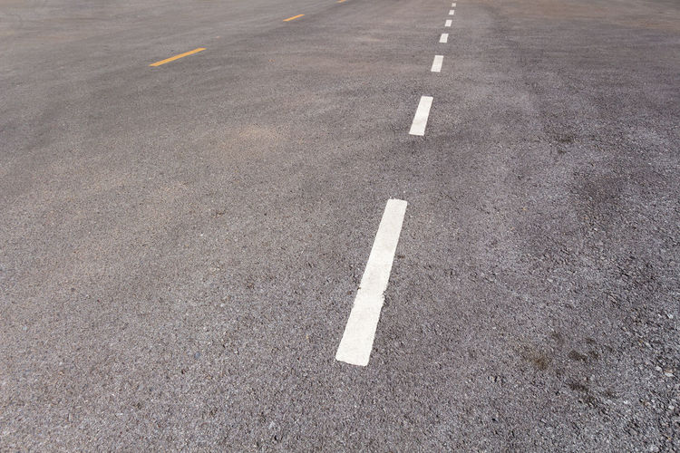 Arrow Symbol Asphalt City Communication Day Direction Dividing Line Full Frame Guidance High Angle View Marking No People Outdoors Road Road Marking Sign Street Symbol The Way Forward Transportation White Color