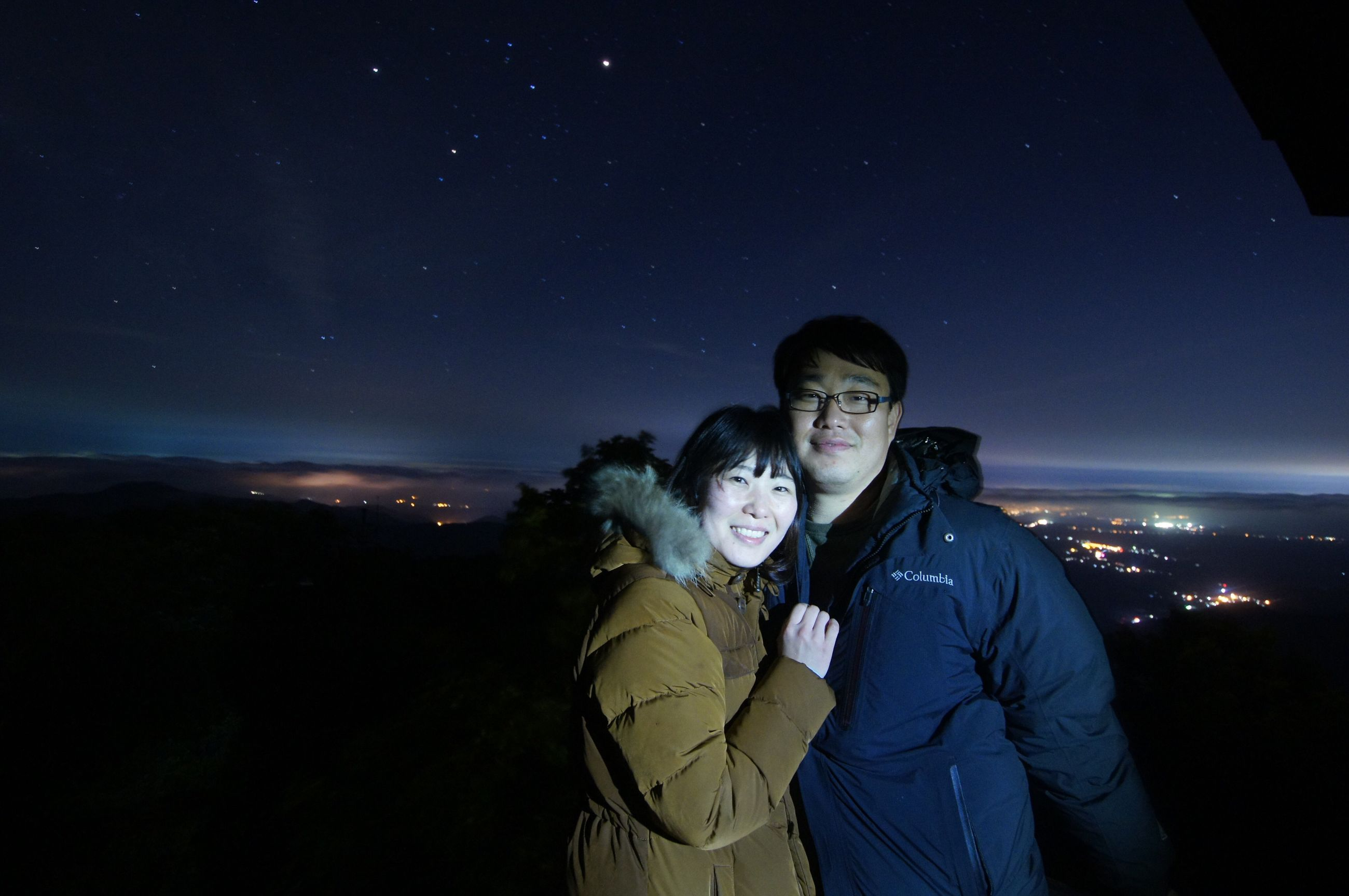 night, star - space, illuminated, standing, waist up, low angle view, star field, sky, casual clothing, enjoyment, tourism, exploration, astronomy, vacations, adventure, young adult, galaxy, space, nature