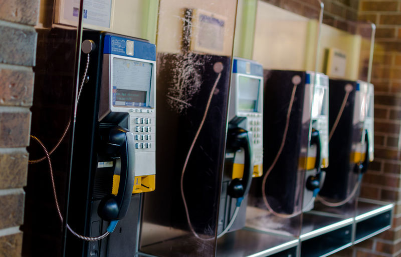 Close-up of pay phones