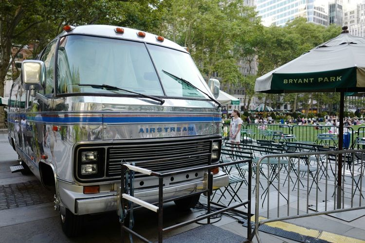 Airstream camper housing 35mm film projector for the Bryant Park Summer, August 2016 Bpfilmfest Bryantpark Bryant Park  Film Festival Filmfestival Airstream Camper Airstream Camper Midtown Manhattan NYC Streetphoto_color Leicaq