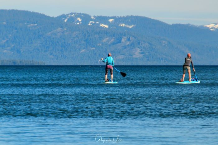 Women paddling on the lake. Beauty In Nature Blue Day Lake Tahoe Water Sports Lake Tahoe, Ca Mountain Nature Outdoors Paddling Scenics Sea Sky Summer Water