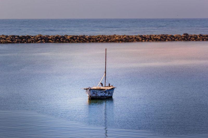 Ship In Sea Against Sky