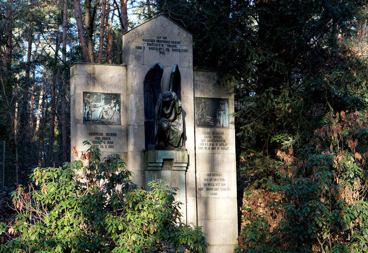 tombstone in Stahnsdorf, Germany Cemetery Plant Architecture Tree Built Structure Sculpture Statue Day Human Representation No People Grave Art And Craft Religion The Past History Representation Nature Text Tombstone Outdoors Architectural Column Stahnsdorf