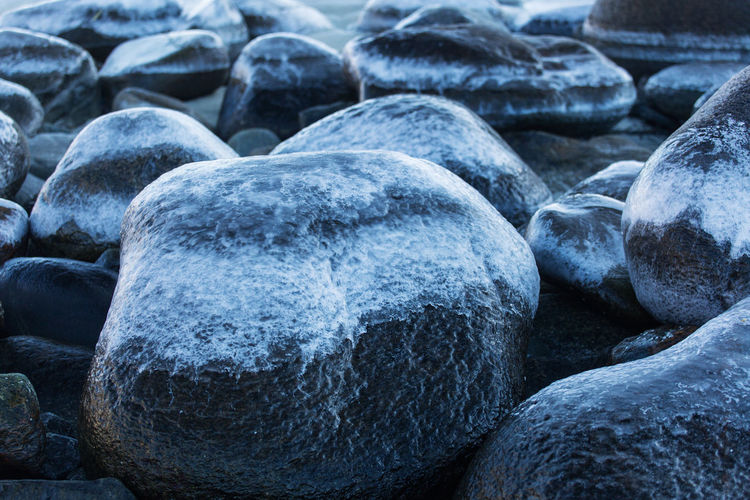 Close-up of stones on water