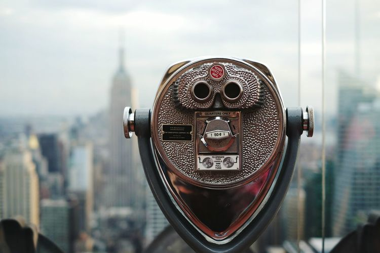 Close-Up Of Coin-Operated Binoculars Against Empire State Building