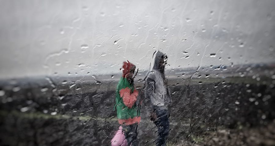 Rain Men in A.A ,Ethiopia. A.A Ethiopia Ethiopian Photography 🇪🇹 Rain In Car
