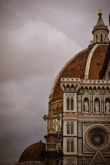 Low Angle View Of Florence Cathedral Dome Against Cloudy Sky