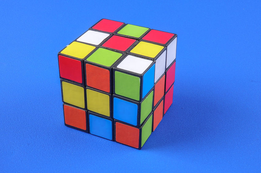 RUBIK'S CUBE , CREATIVITY TOY Creativity Rubik Cube Block Blue Blue Background Circle Close-up Colored Background Copy Space Cube Shape Design Geometric Shape Indoors  Intelligence Multi Colored No People Rubik Shape Still Life Studio Shot Toy Toy Block Vibrant Color Wood - Material