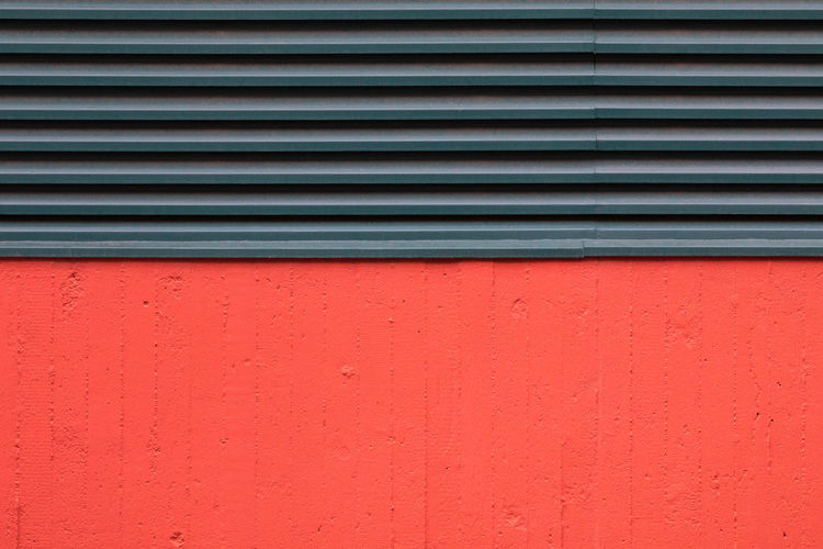 Red concrete wall and green air duct Abstract Air Duct Architecture Backgrounds Building Exterior City Concrete Contrasts Copy Space Day Full Frame Green Color Metal Outdoors Pattern Red Simplicity Striped Vibrant Color Wall - Building Feature Minimalist Architecture