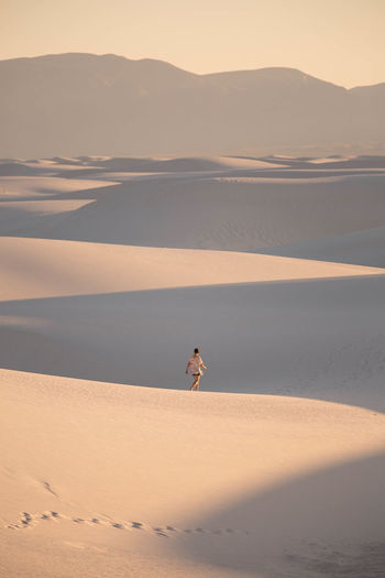 Young Woman On Sand Dune In Desert