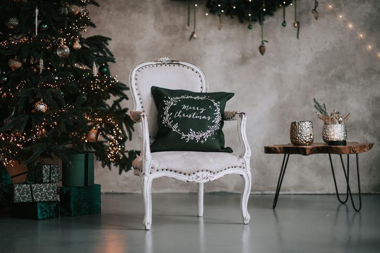 Illuminated christmas decorations on table