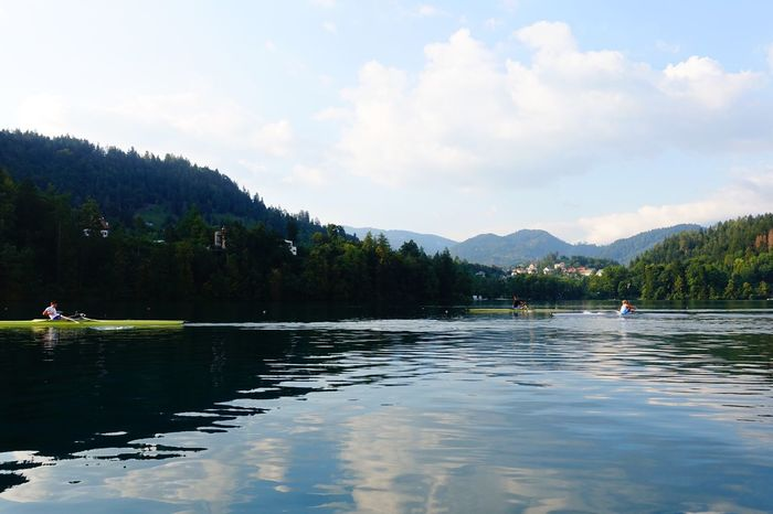 Bled, Slovenia Water Tranquil Scene Tranquility Mountain Waterfront Scenics Sky Cloud Beauty In Nature Cloud - Sky Nature Reflection Calm Day Green Non-urban Scene Majestic Outdoors Countryside Remote Rowing Rowboat Rowboats Fresh On Eyeem